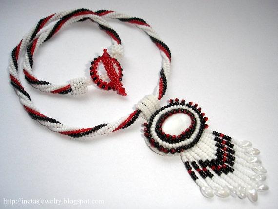 Necklace with bead embroidery cabochon.