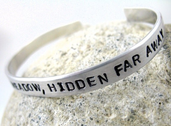 Hunger Games Inspired Bracelet - Deep in the Meadow, Hidden Far Away - Hand Stamped Aluminum Cuff - customizable