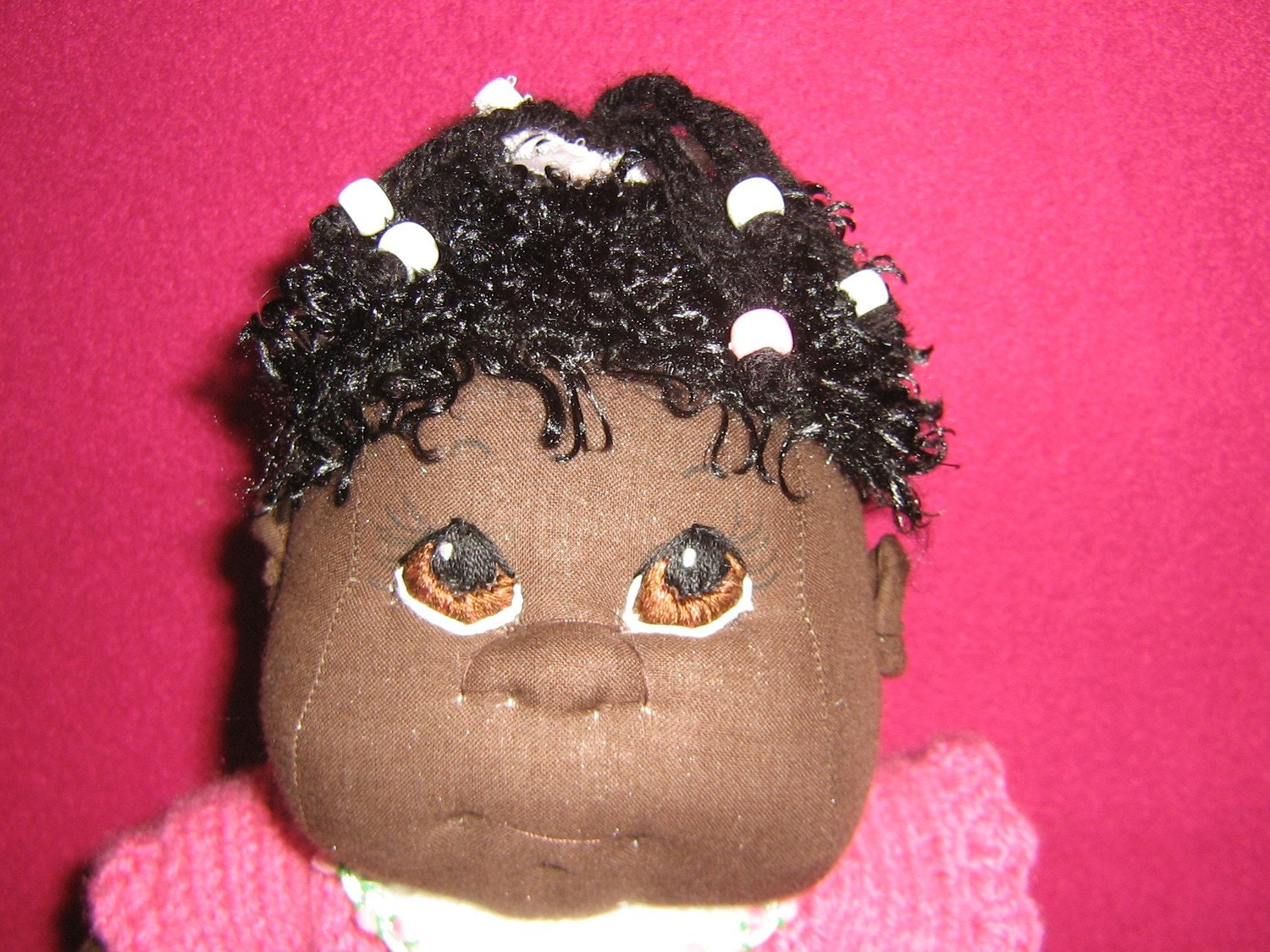 african american baby girl soft sculptured doll with braids and beads