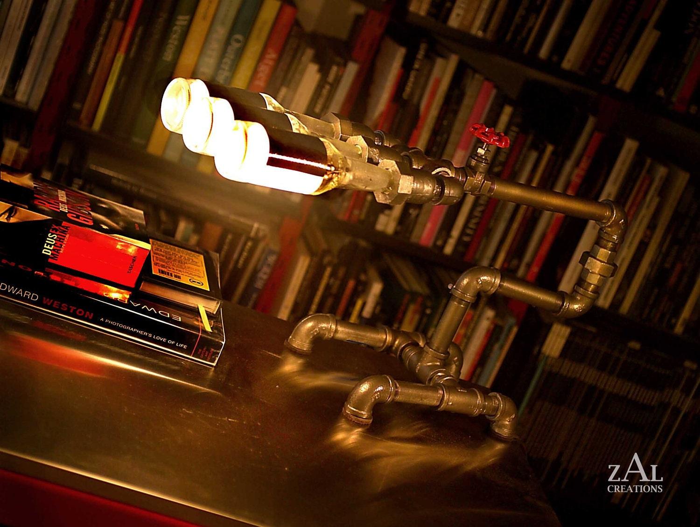 Desk lamp. Beer bottles, Plumbing pipe & fittings at $385 Via : Etsy title=
