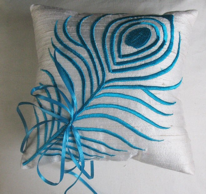 This wedding ring pillow is made from art silk with turquoise peacock
