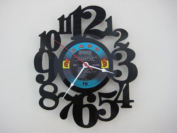 Handcrafted vinyl record clock (artist is Robertino) etsy