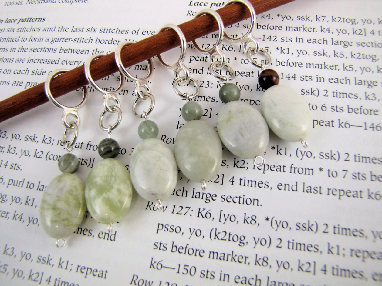 set of 6 oval stitch markers, new jade ranging from light grass green & mottled to very pale grey-green